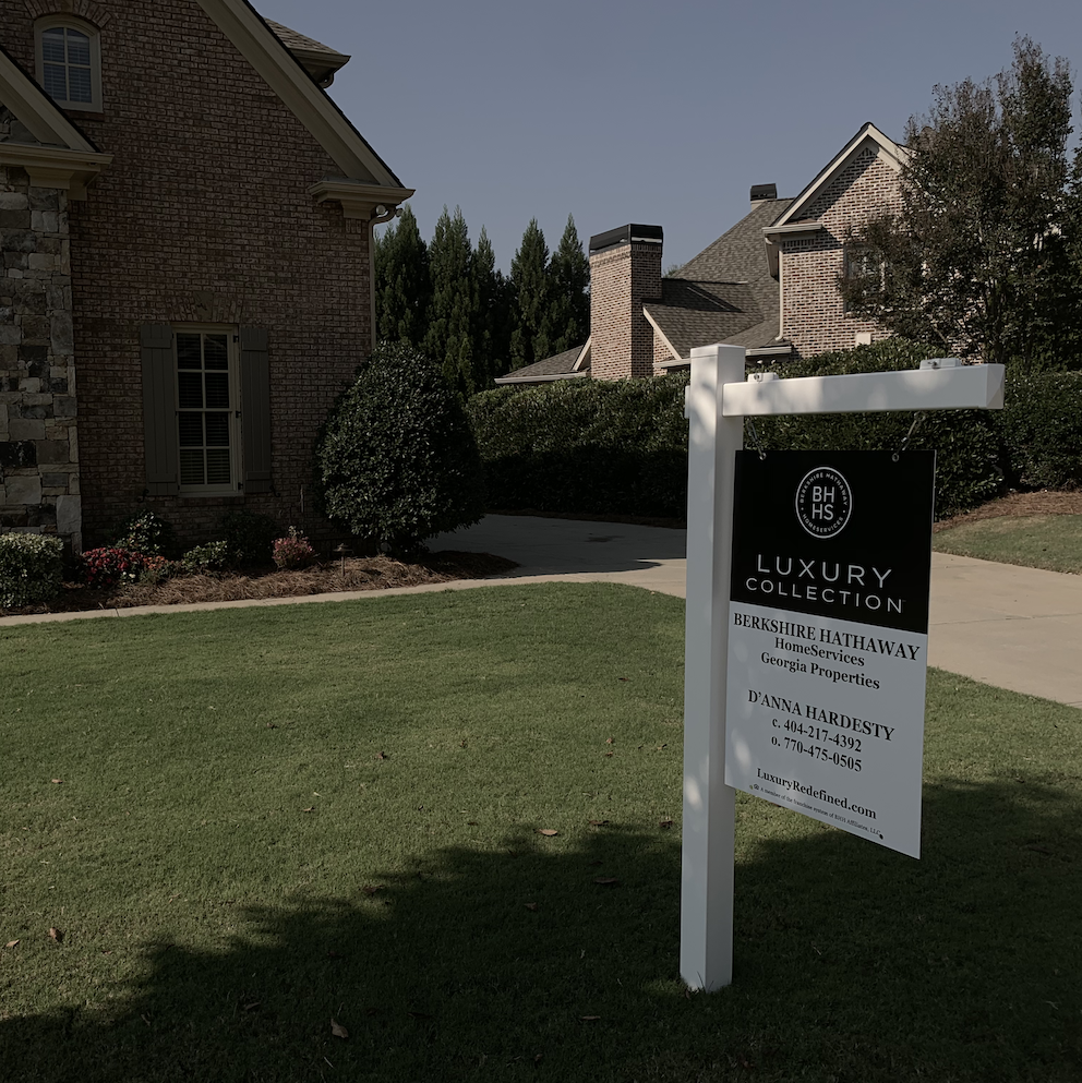 Berkshire Hathaway Home Services sign on White Vinyl Post