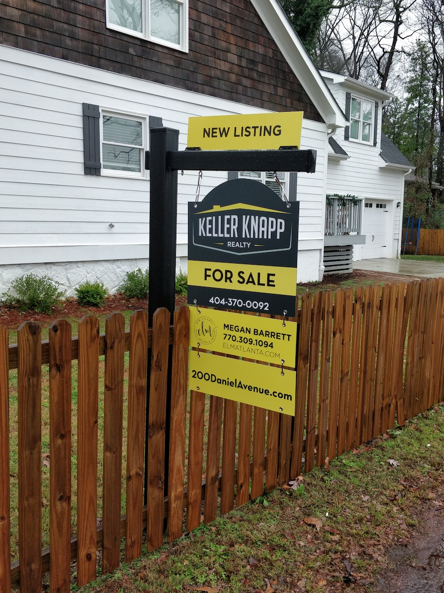 Keller Knapp sign over a fence on a 7 foot tall Black Vinyl Post