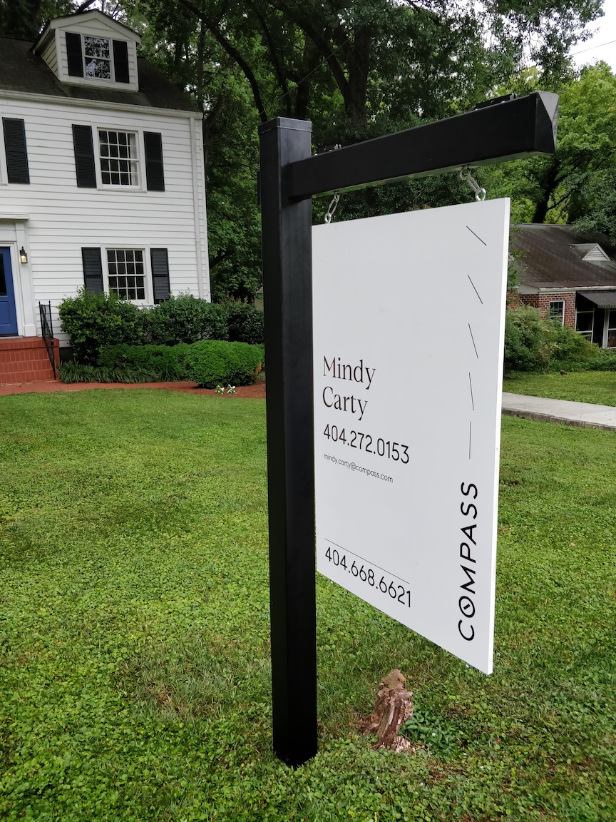 Black Vinyl Real Estate Sign Post with White Compass Sign