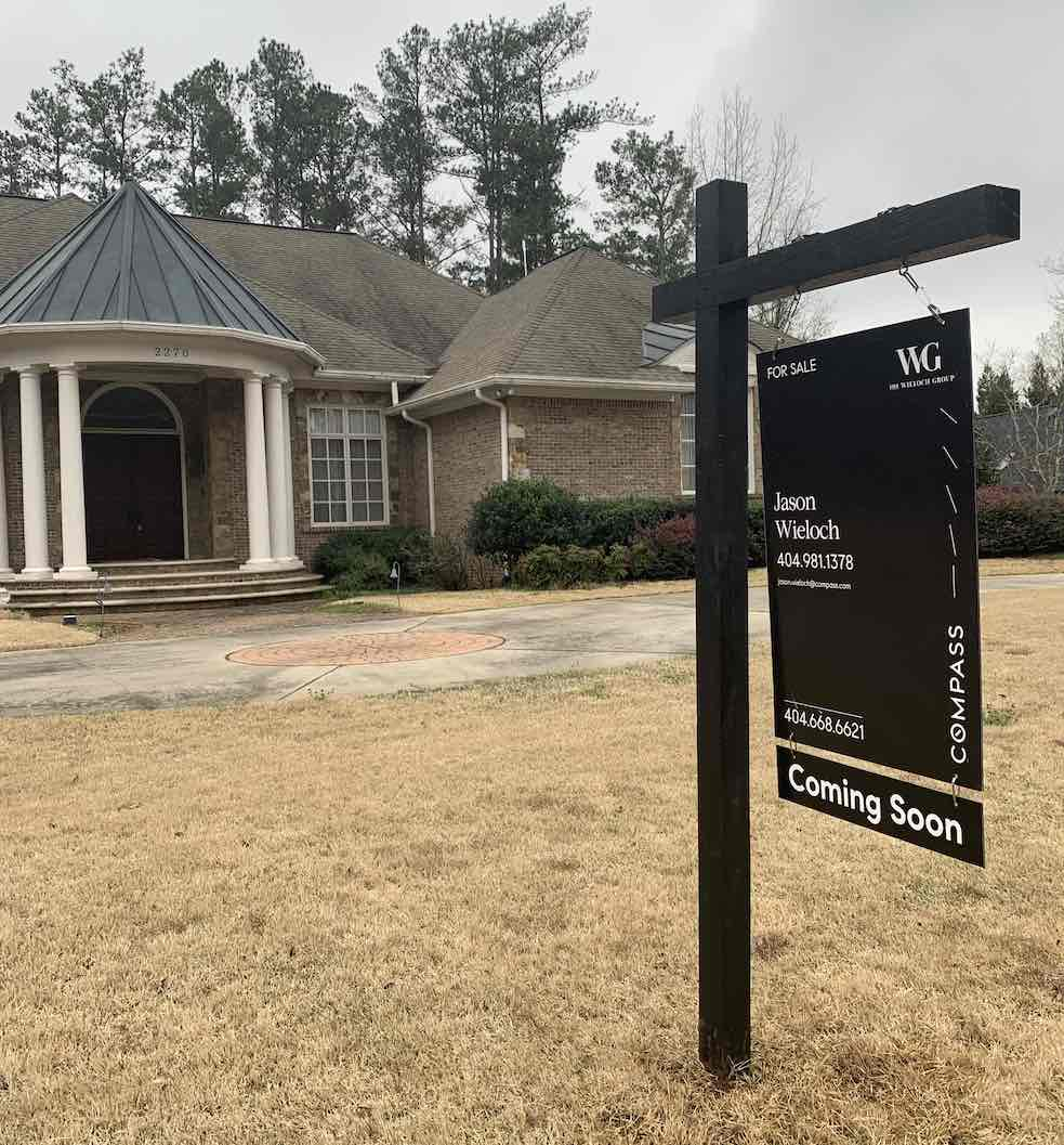 Black Wood Real Estate Sign Post with a Compass Sign