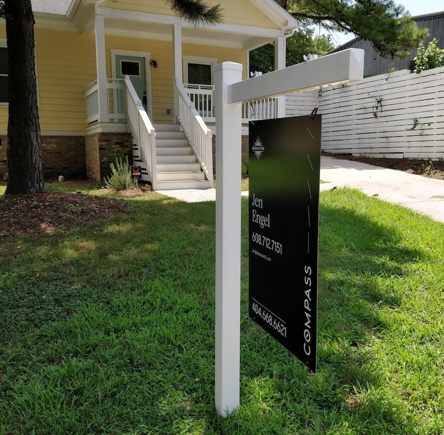 White Vinyl Real Estate Sign Post with a black sign
