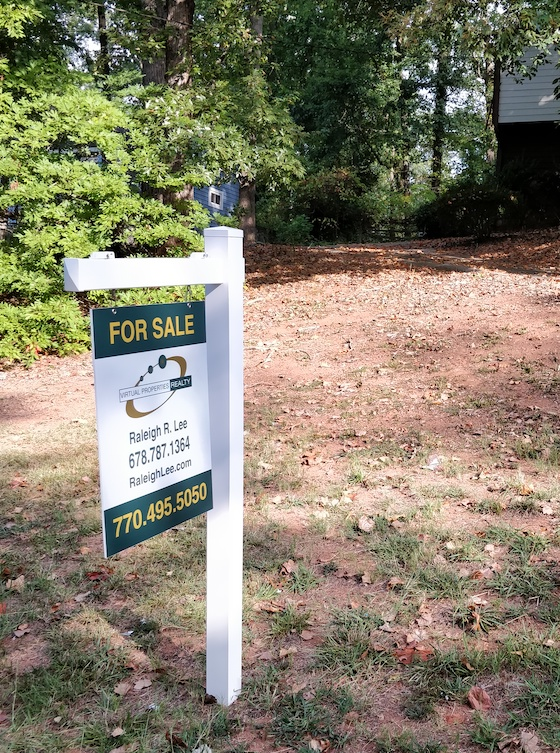 White Vinyl Real Estate Post with a Virtual Properties sign